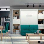 Cama abatible vertical con sofá y librerías